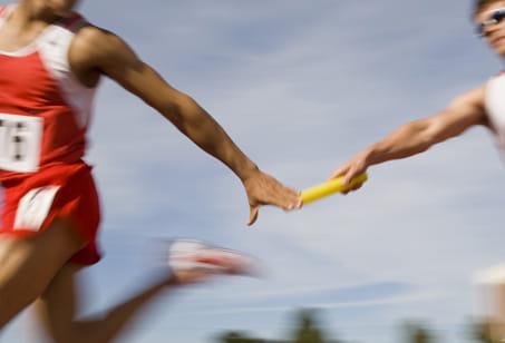 Baton being passed in a relay