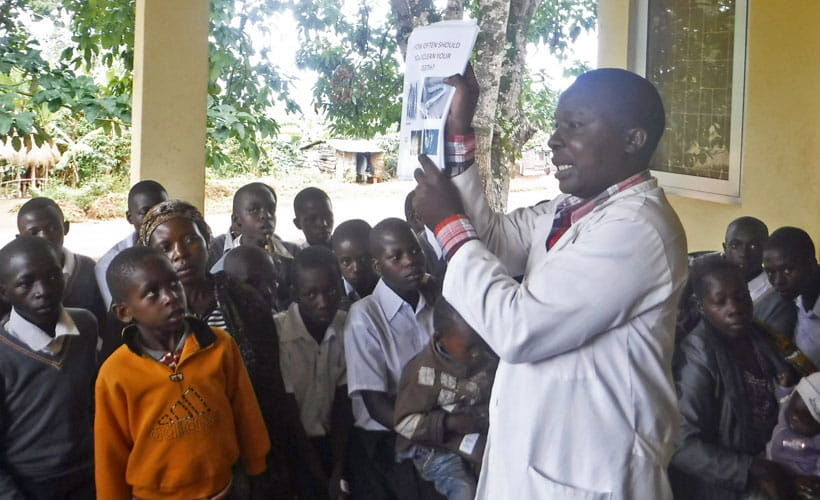 Tanzanian dentist talking to patients