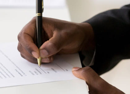 Close up of man signing contract